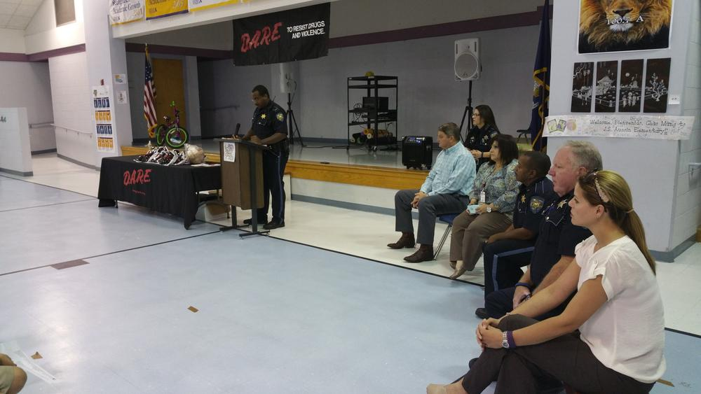 Lt. Alexander Barnes at J.S. Aucoin Elem at a podium