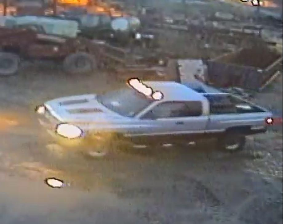 Suspect Vehicle - silver and maroon truck with headlights and overhead lights on