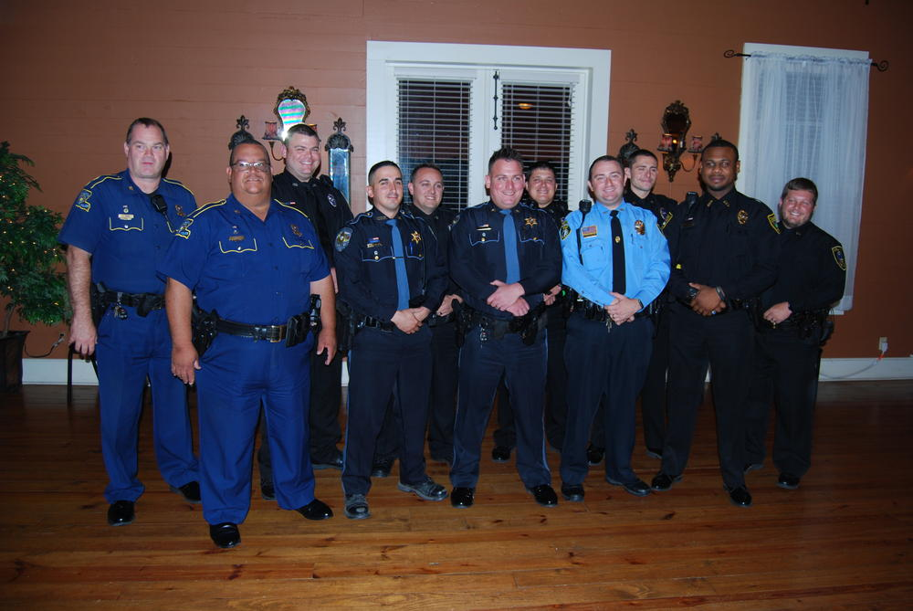 11 officers standing in uniform