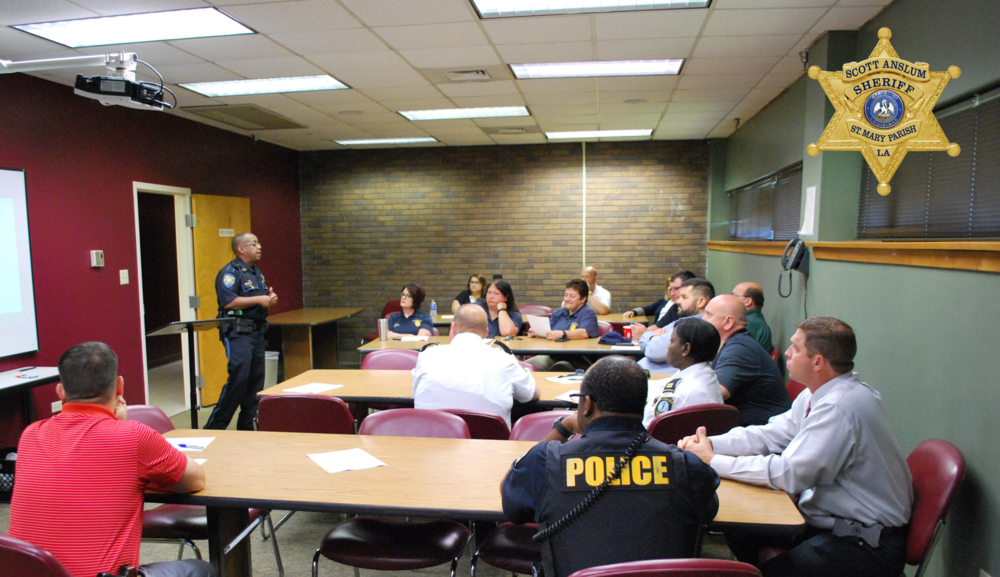 SRO presenting information to a group of officers