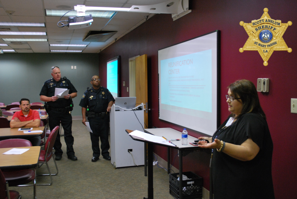 Woman speaking to a room of officers
