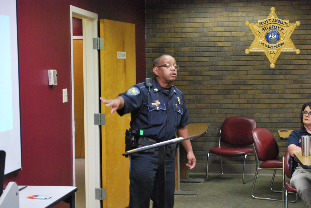 Man in uniform pointing at the projector board