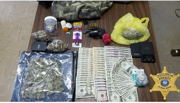 Table full of recovered narcotics and money arranged on a table.
