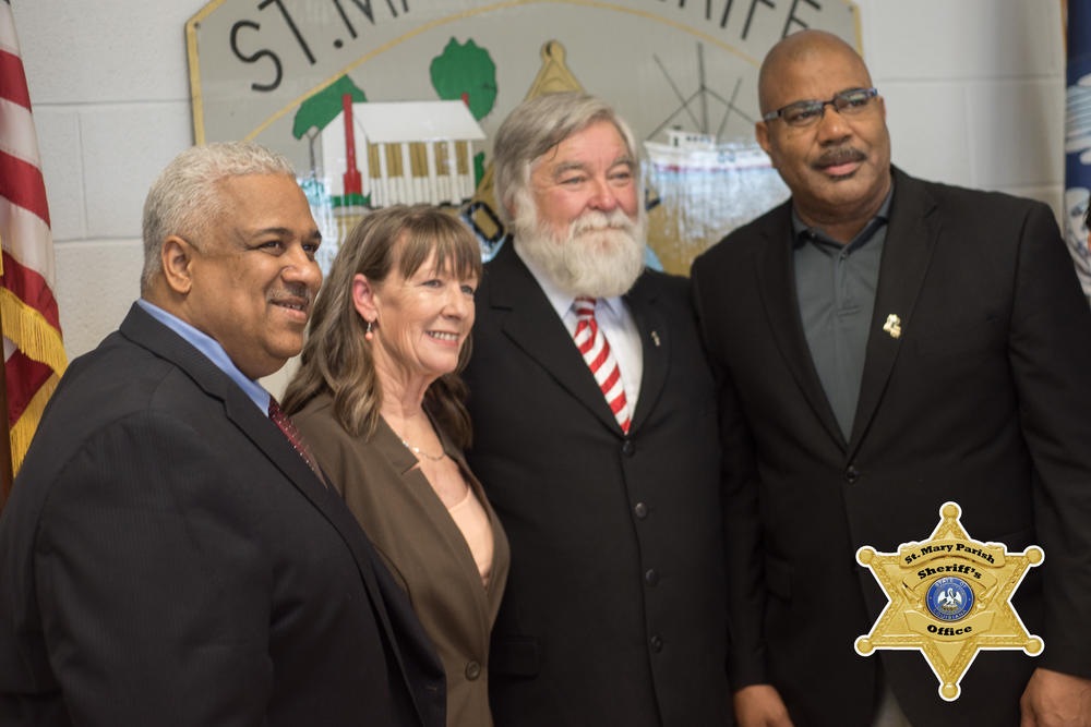 Sheriff Blaise Smith with three other people
