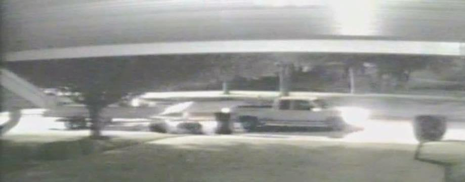 white 4-door truck from security camera footage