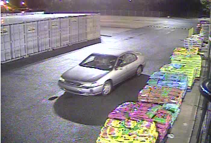 tan 4-door sedan - Suspect Vehicle