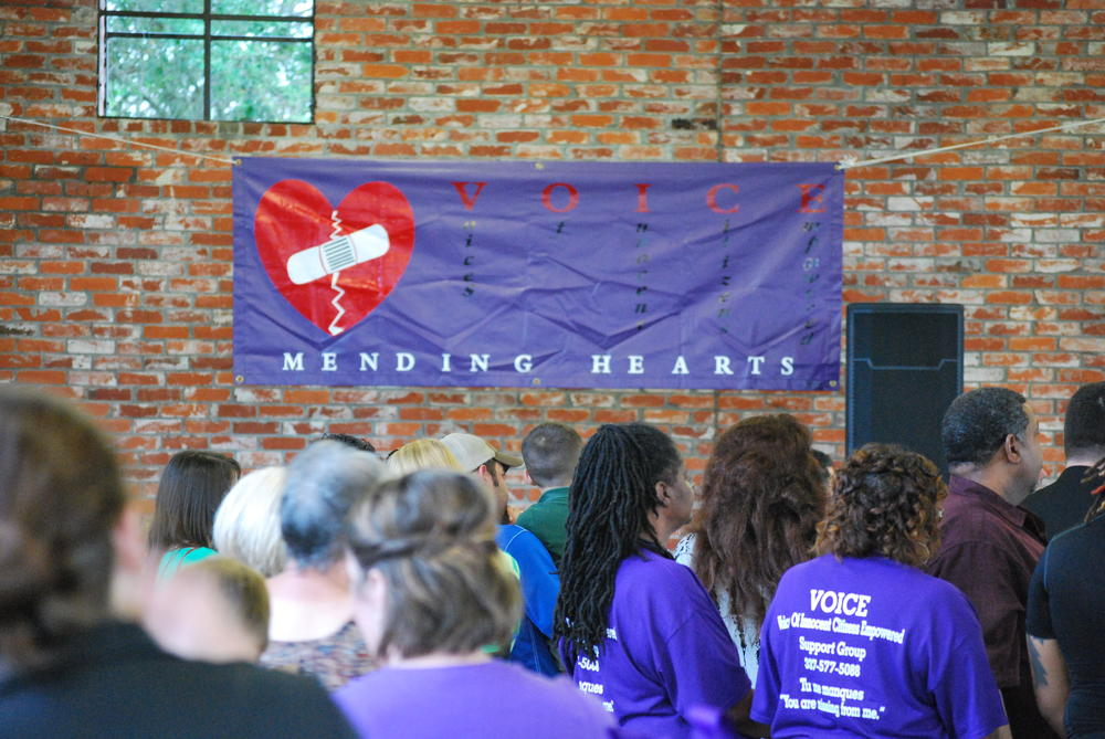 Banner on wall that says VOICE Mending Hearts