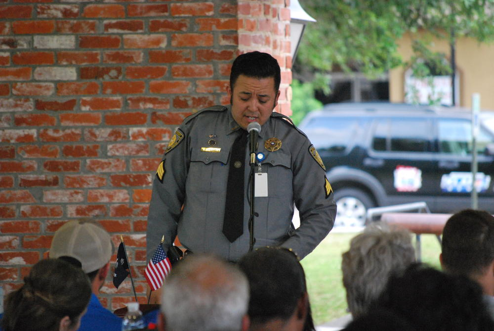 Sgt Jose Alexander singing into microphone